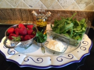 Ingredients for a strawberry & baby spinach salad
