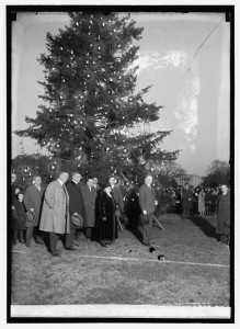 Pres. Calvin Coolidge lights the first outdoor Christmas Tree on the White House Lawn