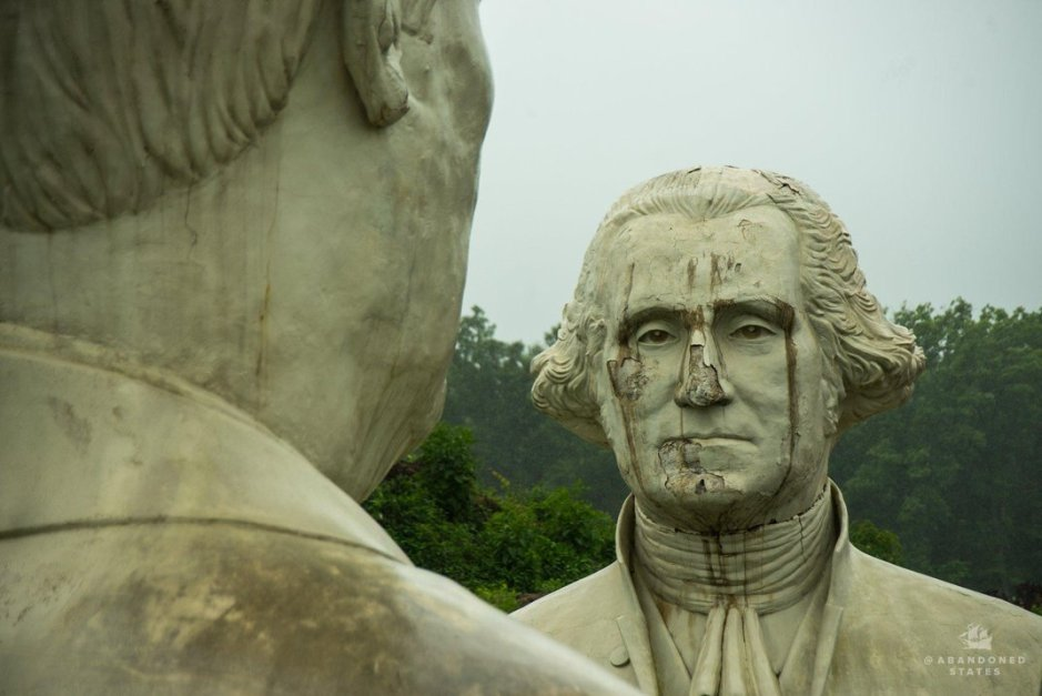 Crumbling concrete bust of President George Washington