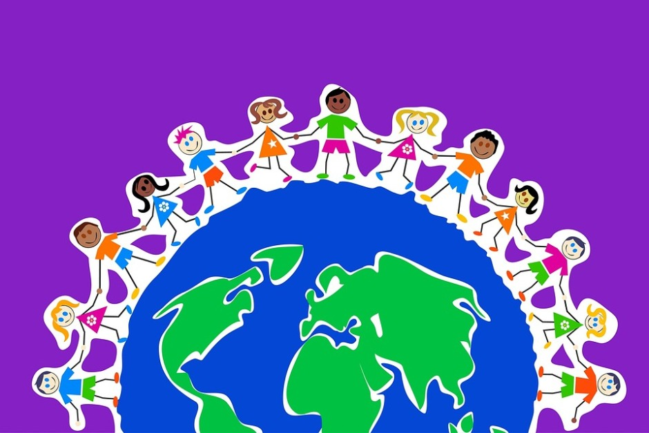 Colorful illustration of the globe surrounded by children of all nations holding hands