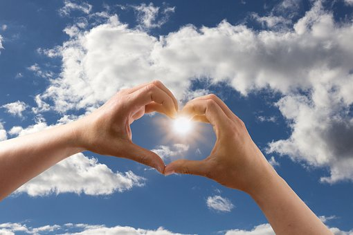 heart-hands reaching to the blue sky