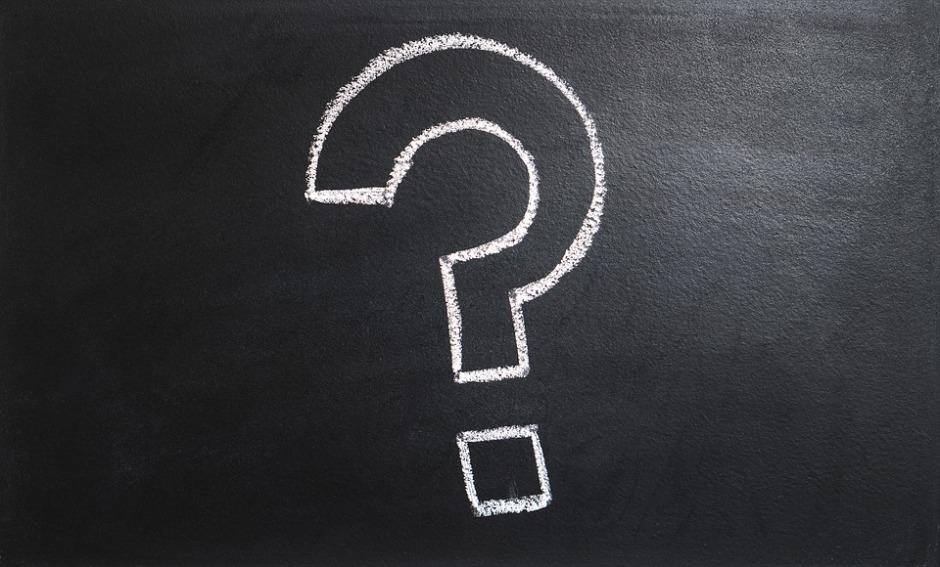 A question mark written in chalk on a black board