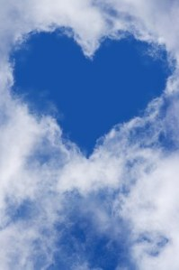 Cumulus Clouds that open to the sky forming the shape of blue heart
