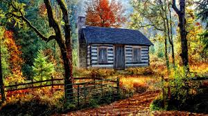 A log cabin in the autumn woods