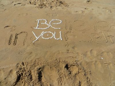Believe in yourself scribed in the sand