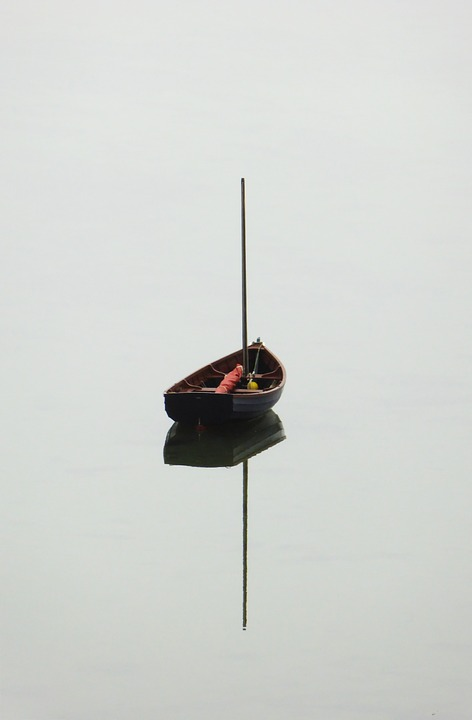small boat on calm water
