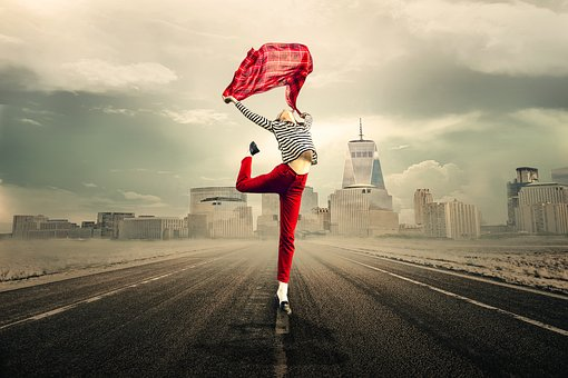 girl wearing red pants jumping for joy