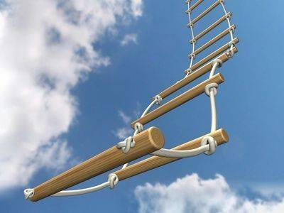 a rope ladder against a blue sky