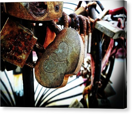 Locks symbolizing love locked on a bridge